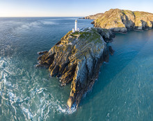 Aerial View Of The Beautiful Cliffs Close To The Historic South Stack Lighthouse On Anglesey - Wales