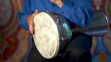 Playing Fast Drumming Rhythm On Metal Turkish Daholla With Arabic Background.