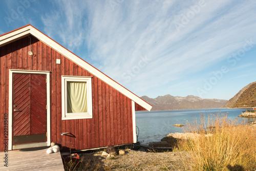 Foto op Aluminium Arctica Wooden Beach Hut in Tromso Fjord, Norway