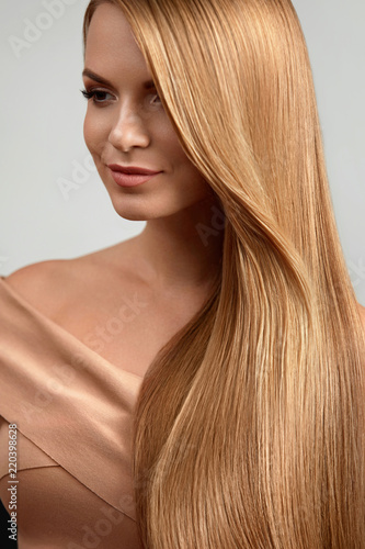 Fotografie, Obraz  Long Blonde Hair. Beautiful Woman With Healthy Straight Hair