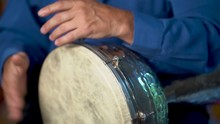Closeup Of Playing Fast Drumming Rhythm On Metal Turkish Daholla With Arabic Background.