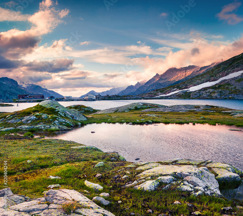 Tuinposter Purper Colorful summer evening on the Totensee lake on the top of Grimselpass