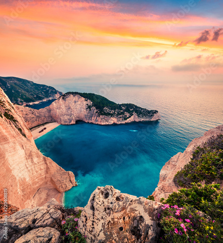 Poster Bleu nuit Fabulous spring scene on the Shipwreck Beach. Colorful sunset on the Ionian Sea, Zakinthos island, Greece, Europe. Beauty of nature concept background. Artistic style post processed photo.