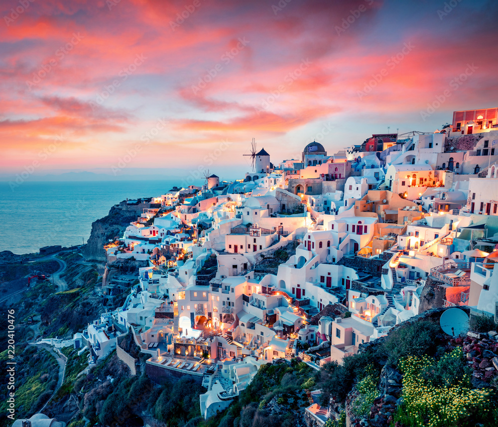 Fototapeta Impressive evening view of Santorini island. Picturesque spring sunset on the famous Greek resort Oia, Greece, Europe. Traveling concept background. Artistic style post processed photo.