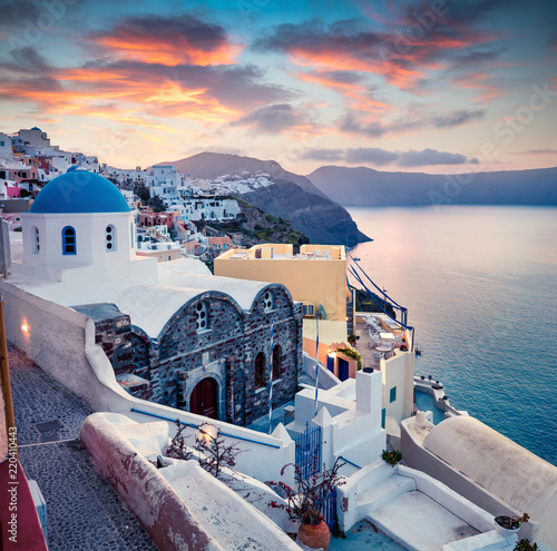 Aluminium Prints Santorini Dramatic morning view of Santorini island. Picturesque spring sunrise on the famous Greek resort Oia, Greece, Europe. Traveling concept background. Artistic style post processed photo.