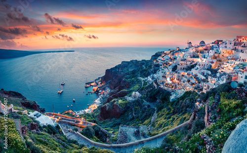 Fototapeta Impressive evening view of Santorini island. Picturesque spring sunset on the famous Greek resort Oia, Greece, Europe. Traveling concept background. Artistic style post processed photo. obraz