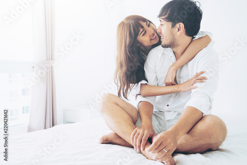 Fototapeta Happy young couple relaxing in the home bedroom. obraz