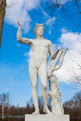 PARIS, FRANCE - MARCH, 2018: Statue of Apollo with a lyre at the garden of the V Canvas Print