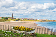 Ornamental Boat Containing Flowers, With Tynemouth's Coastline In The Background
