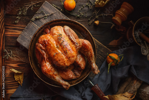 Homemade roasted chicken on a rustic wooden background. Close up. Top view