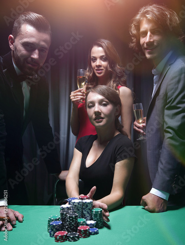 Woman doing all-in playing poker Canvas Print
