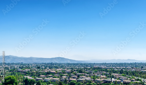 Southern California houses in inland empire area on hot summer day Wallpaper Mural