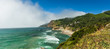 Panoramic view of rugged Oregon coast with fog bank over ocean
