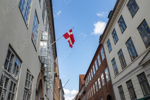 Flag of Denmark on a street in Copenhagen Canvas Print
