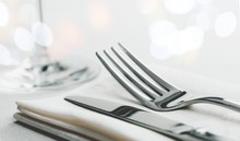 Table Setting With Fork And Knife On Napkin