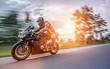 Leinwandbild Motiv motorbike on the road riding. having fun riding the empty road on a motorcycle tour / journey