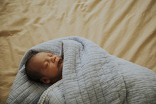 Infant Baby Fast Asleep On The Bed