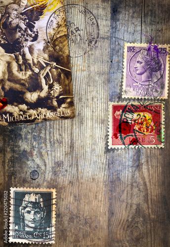Foto op Aluminium Imagination Sfondo vecchia maniera in legno antico con vecchi francobolli italiani e antica immagine religiosa di San Michele Arcangelo