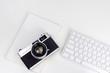 Leinwanddruck Bild - Minimal white workspace with vintage camera