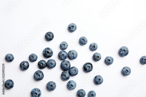 Flat lay composition with tasty blueberry on white background