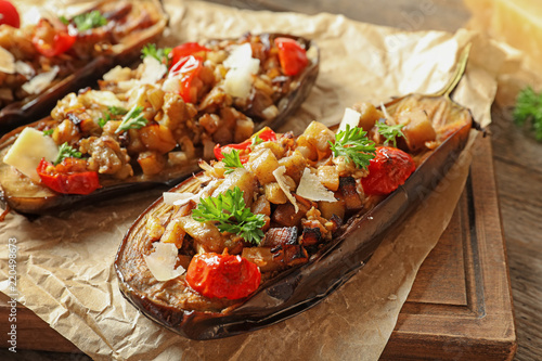 Obraz Tasty stuffed eggplants on wooden table, closeup - fototapety do salonu