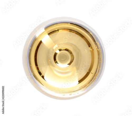Glass of champagne on white background, top view