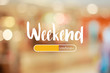 canvas print picture - Weekend loading word on blurred in shopping mall background