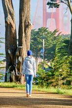 Woman Walking On California Coastal Trail In San Francisco