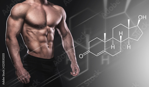 Fotografie, Obraz  Muscular male body and testosterone hormone formula