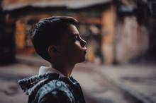 Portrait Preteen Boy On A Street In A Big City Alone.