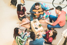 Millennials Trendy Friends Having Fun In Hostel Living Room - Happy Young People Enjoying Time Together Playing Music And Drinking Shots - Friendship And Youth Concept - Soft Focus On Top Left Man