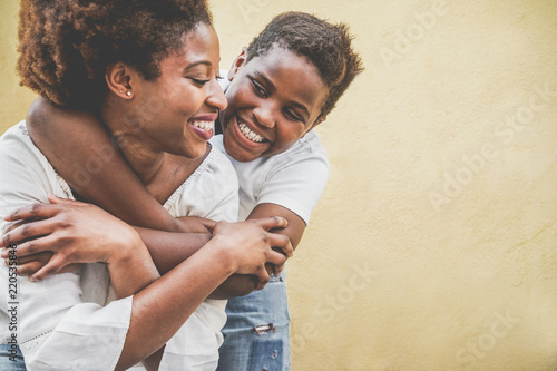 Fotografie, Tablou  Happy young mother having fun with her child