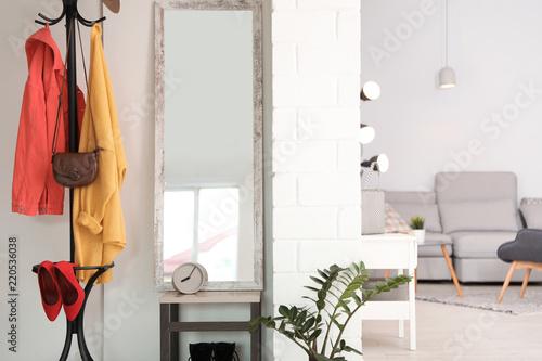 Obraz Stylish hallway interior with large mirror - fototapety do salonu
