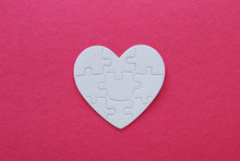Top View Image Of Paper White Heart Puzzle Over Pink Background. Health Care, Donate, World Heart Day And World Health Day Concept.