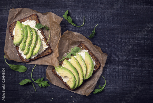 Sandwiches with rye bread and fresh sliced avocado