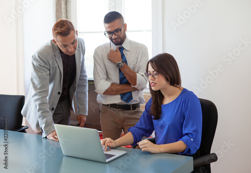 Fototapety, obrazy: Financial analyst giving advice to two businessmen. Smart expert showing and explaining analysis result to colleagues. Consulting concept