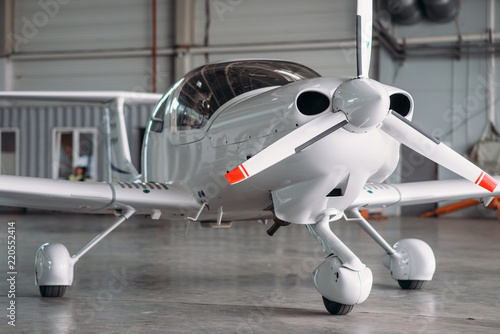 Fototapeta premium Small private turbo-propeller airplane in hangar