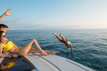 Group Of Friends Traveling On A Modern Yacht At Open Sea, And Enjoying A Good Summer Day. Vacation, Holiday, Summertime Concept.