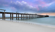 Old concrete bridge on the beach