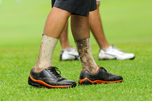 Dirty Legs Of Golf Player