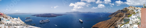 Foto auf Leinwand Santorini Beautiful panoramic view from touristic Fira town to caldera and volcano and cruise ship at summer sunny day. Santorini Island, Thira, Greece.