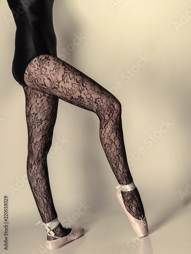 Photo  Female legs dancer in ballet shoes