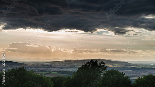 Beautiful dramatic Summer sunset landscape over English countryside with stunning light