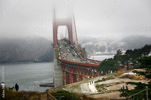 Spoed Foto op Canvas Verenigde Staten San Francisco, Golden Gate Bridge under fog. Traffic and tourists.