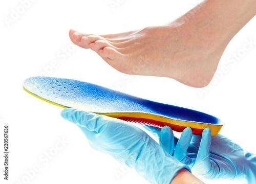 Keuken foto achterwand Pedicure orthopedic insole in the hands