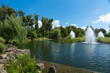 Ornamental Fountains In A Lake In A Park