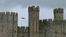 The Towers Of Caernarfon Castle In The Rain , Often Anglicized As Carnarvon Castle, Is A Medieval Fortress In Caernarfon, Gwynedd, North-west Wales