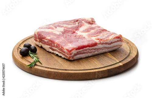 Piece of smoled pork meat over white, with paths