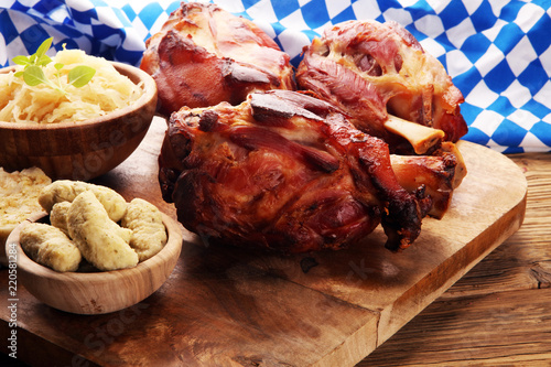 Roasted pork knuckle. Ham and bacon are popular foods in the west. German Schweinshaxe or Haxe.