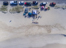 Aerial View Of A Group Of People Camping On The Beach